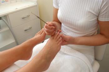 Chiropodist working on an ingrown toenail
