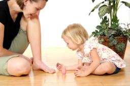 Toddler painting mums toenails