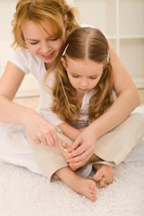 mum and daughter cutting toenails